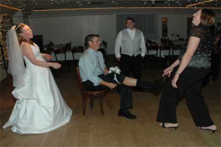 traditions for wedding receptions The Tables Get Turned For This Garter